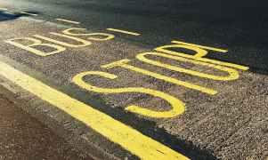 bus stop printed on asphalt road