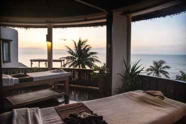 two massage table near palm trees