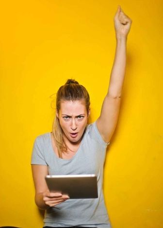 photo of a woman holding an ipad